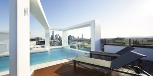 Omega Apartments rooftop pool overlooking Brisbane's CBD (image supplied by the developer)
